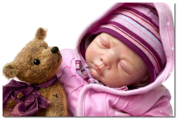 Reborn Doll Holding a Teddy Bear